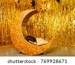 golden lounger in the form of... | Shutterstock . vector #769928671