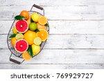 fresh citrus fruits in basket.... | Shutterstock . vector #769929727