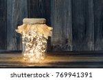 christmas light in a glass jar... | Shutterstock . vector #769941391