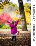 playing in the leaves   Shutterstock . vector #769960951
