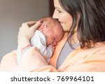 a young mother enjoys the first ... | Shutterstock . vector #769964101