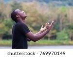 african man praying for thank... | Shutterstock . vector #769970149