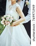 bride is holding her bouquet of ... | Shutterstock . vector #769971949