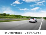 a silver crossover car driving... | Shutterstock . vector #769971967