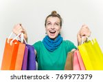 happy woman with shopping bags ... | Shutterstock . vector #769977379
