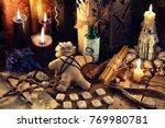 voodoo doll  black candles ...   Shutterstock . vector #769980781
