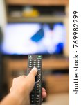 hand holding remote control...   Shutterstock . vector #769982299