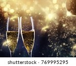 two champagne glasses ready to... | Shutterstock . vector #769995295