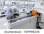 scientists working in laboratory | Shutterstock . vector #769998235