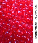 red pearls made from starch. | Shutterstock . vector #769998721