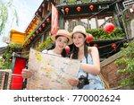 happy two asian women tourist... | Shutterstock . vector #770002624