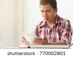 asian middle aged man reading... | Shutterstock . vector #770002801