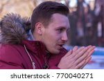 male cold hands. winter. | Shutterstock . vector #770040271