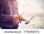 close up of man checklist using ... | Shutterstock . vector #770040571