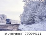 light truck carries the load on ... | Shutterstock . vector #770044111