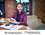 happy woman manager holding... | Shutterstock . vector #770054551