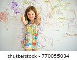 curly cute little toddler girl... | Shutterstock . vector #770055034