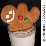 gingerbread man in milk | Shutterstock . vector #770063239