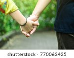 hands of mother and daughter... | Shutterstock . vector #770063425