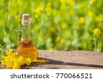 rape oil on wooden table in... | Shutterstock . vector #770066521