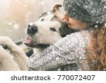 Stock photo image of young girl with her dog alaskan malamute outdoor at autumn or winter domestic pet husky 770072407
