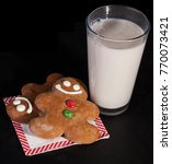 gingerbread man and glass of... | Shutterstock . vector #770073421