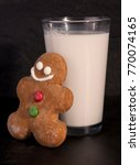 gingerbread man and glass of... | Shutterstock . vector #770074165