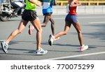 marathon runner legs running on ...   Shutterstock . vector #770075299