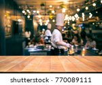 wood table top with blur chef... | Shutterstock . vector #770089111