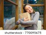 hands holding craft paper gift... | Shutterstock . vector #770095675