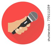 the hand holds the microphone.... | Shutterstock .eps vector #770111359