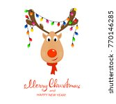 head of happy reindeer with red ... | Shutterstock . vector #770146285