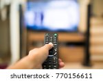 hand holding use remote control ...   Shutterstock . vector #770156611