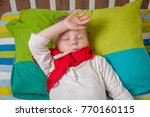 sick boy with thermometer... | Shutterstock . vector #770160115