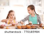 cute girls decorating cupcakes... | Shutterstock . vector #770185984