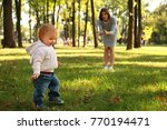 mother with adorable little... | Shutterstock . vector #770194471