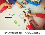 kids and teacher building robot ... | Shutterstock . vector #770222059