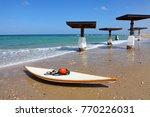 white lifeguard board with red... | Shutterstock . vector #770226031