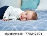 friendly baby girl smile lying... | Shutterstock . vector #770242801
