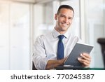 happy businessman smiling and... | Shutterstock . vector #770245387