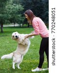 image of girl holding dog by... | Shutterstock . vector #770248051