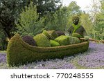 Small photo of GATINEAU, CANADA – AUGUST 27, 2017: A sculpture of a trader rowing a canoe at the MOSAICANADA 150 exhibition celebrating the 150 anniversary of Canada