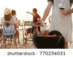 young people having barbecue... | Shutterstock . vector #770256031