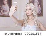 a glamorous girl  a blond woman ... | Shutterstock . vector #770261587