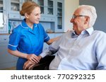 nurse talking with senior man... | Shutterstock . vector #770292325