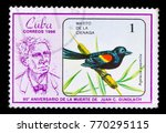 Small photo of Samara, Russia - November 25, 2017: Retro postage stamp printed in Cuba in 1986, shows Red-shouldered blackbird, Agelaius assimilis, 90th anniversary since death of Juan Gundlach