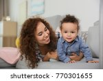cute baby and young mother... | Shutterstock . vector #770301655