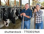 portrait of couple farmers who... | Shutterstock . vector #770301964