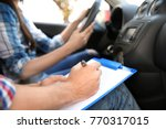 driving instructor writing down ...   Shutterstock . vector #770317015