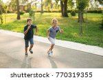 two children are playing in the ... | Shutterstock . vector #770319355